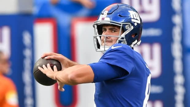 Aug 14, 2021; East Rutherford, New Jersey, USA; New York Giants quarterback Daniel Jones (8) warms up before the game between the New York Giants and the New York Jets at MetLife Stadium.