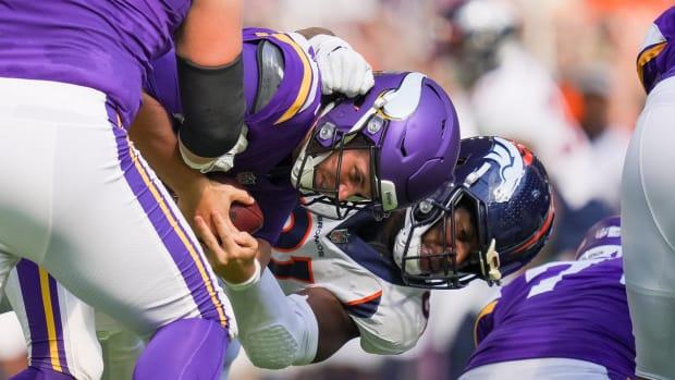 Denver Broncos linebacker Andre Mintze (91) sacks Minnesota Vikings quarterback Jake Browning (3) in the second quarter at U.S. Bank Stadium.