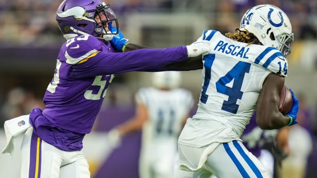 Aug 21, 2021; Minneapolis, Minnesota, USA; Minnesota Vikings outside linebacker Nick Vigil (59) tackles Indianapolis Colts wide receiver Zach Pascal (14) during the first quarter at U.S. Bank Stadium.