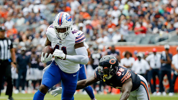 Buffalo Bills tight end Reggie Gilliam (41) runs for a touchdown past Chicago Bears free safety Tashaun Gipson (38) during the second quarter at Soldier Field.