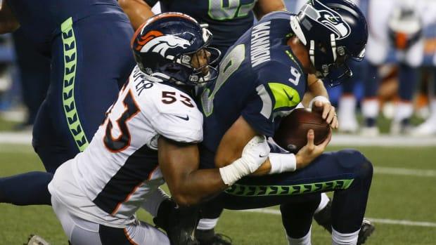 Denver Broncos linebacker Jonathon Cooper (53) sacks Seattle Seahawks quarterback Sean Mannion (9) during the fourth quarter at Lumen Field.