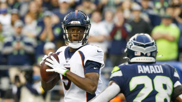 Denver Broncos quarterback Teddy Bridgewater (5) drops back to pass against the Seattle Seahawks during the first quarter at Lumen Field.