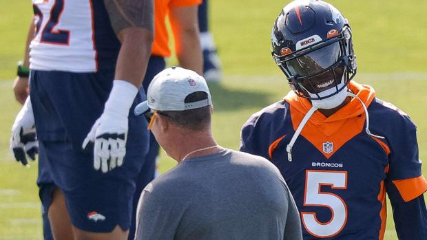 Denver Broncos quarterback Teddy Bridgewater (5) talks with offensive coordinator Pat Shurmur during training camp at UCHealth Training Center.