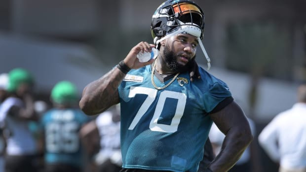 Jaguars T (70) Derwin Gray pours water down his neck as he cools down during a break between drills at Tuesday's minicamp session. The Jacksonville Jaguars held their Tuesday morning session of the team's mandatory minicamp at the practice fields outside TIAA Bank Field, June 15, 2021.
