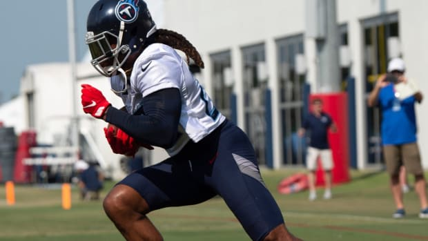 Tennessee Titans running back Derrick Henry (22) runs up the field during a training camp practice at Saint Thomas Sports Park Friday, July 30, 2021 in Nashville, Tenn.