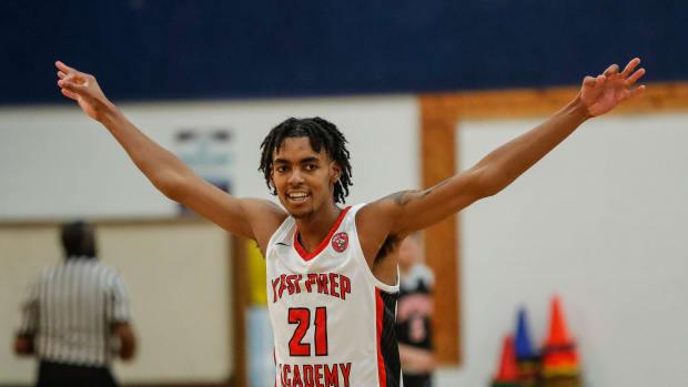 Ypsi Prep forward Emoni Bates (21) celebrates a play against SPIRE Academy during the second half at Central Academy
