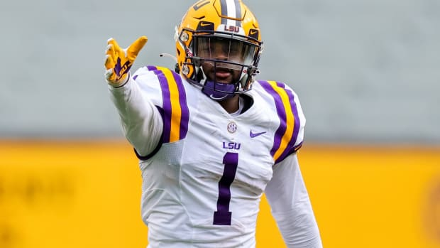 Apr 17, 2021; Baton Rouge, Louisiana, USA; LSU Tigers wide receiver Kayshon Boutte (1) reacts to making a catch against LSU Tigers cornerback Derek Stingley Jr. (24) during the first half of the annual Purple and White spring game at Tiger Stadium.