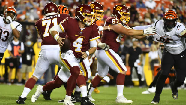 Aug 20, 2021; Landover, Maryland, USA; Washington Football Team quarterback Taylor Heinicke (4) scrambles against the Cincinnati Bengals during the second quarter at FedExField. Mandatory Credit: