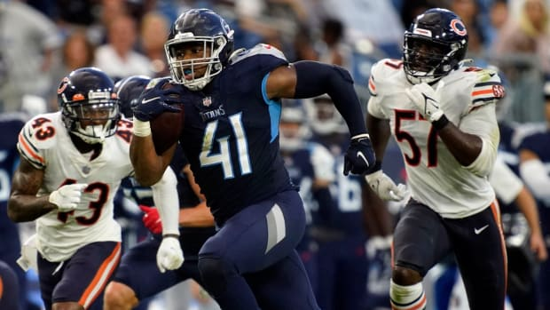 Tennessee Titans fullback Khari Blasingame (41) runs the ball pursued by the Bears defense during the second quarter of an NFL preseason game at Nissan Stadium Saturday, Aug. 28, 2021 in Nashville, Tenn.