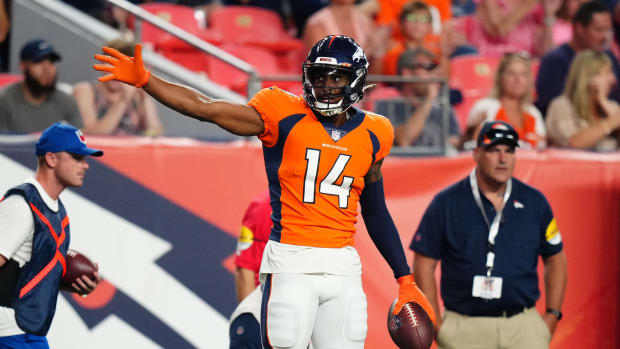 Denver Broncos wide receiver Courtland Sutton (14) celebrates after a first down reception against the Los Angeles Rams in the second quarter during a preseason game at Empower Field at Mile High.