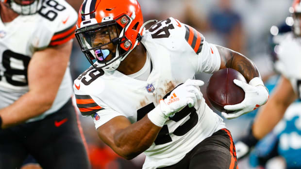 Aug 14, 2021; Jacksonville, Florida, USA; Cleveland Browns running back John Kelly (49) runs the ball against the Jacksonville Jaguars in the second quarter at TIAA Bank Field. Mandatory Credit: Nathan Ray Seebeck-USA TODAY Sports