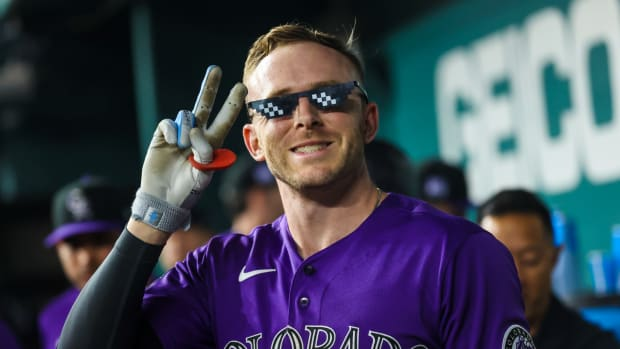 Aug 30, 2021; Arlington, Texas, USA; Colorado Rockies shortstop Trevor Story (27) celebrates after hitting a home run during the seventh inning against the Texas Rangers at Globe Life Field.