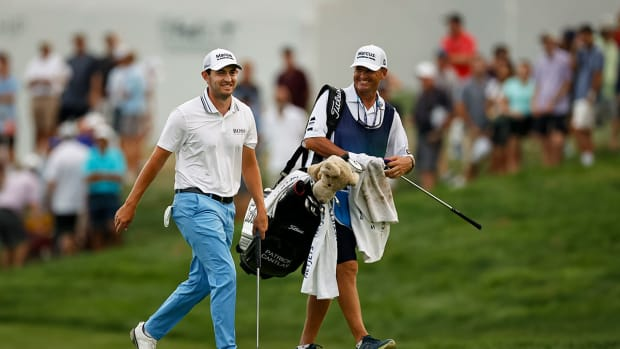 Patrick Cantlay walks with his caddie at the 2021 BMW Championship.