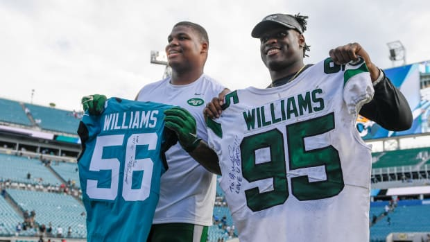 Jaguars LB Quincy Williams with Jets DT Quinnen Williams