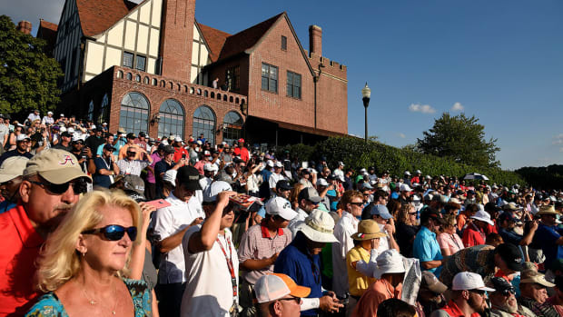 Fans and the clubhouse at East Lake Golf Club in Atlanta.