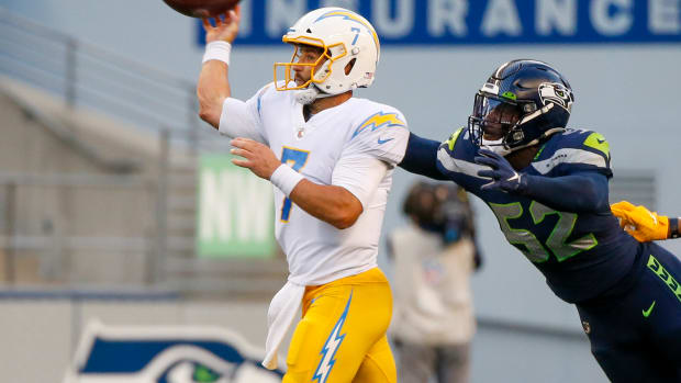 NFL: Los Angeles Chargers at Seattle Seahawks Aug 28, 2021; Seattle, Washington, USA; Los Angeles Chargers quarterback Chase Daniel (7) throws a pass under pressure from Seattle Seahawks defensive end Darrell Taylor (52) during the first quarter at Lumen Field. Mandatory Credit: Joe Nicholson-USA TODAY Sports