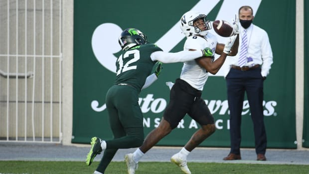 Northwestern Wildcats wide receiver Kyric McGowan (8) is unable to make a catch against Michigan State Spartans cornerback Chris Jackson (12) during the second quarter at Spartan Stadium. Tim Fuller-USA TODAY Sports