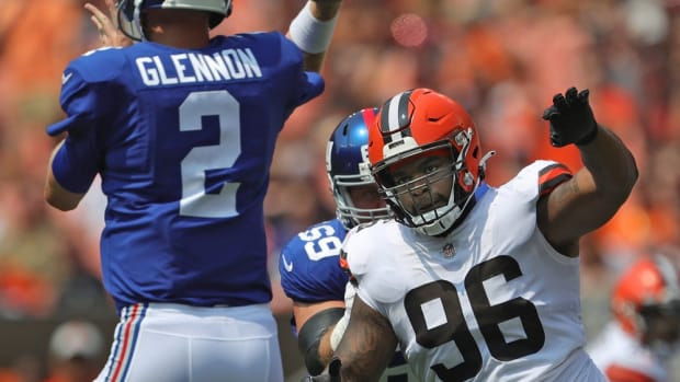 Cleveland Browns defensive tackle Jordan Elliott (96) rushes New York Giants quarterback Mike Glennon (2) during the first half of an NFL preseason football game, Sunday, Aug. 22, 2021, in Cleveland, Ohio. [Jeff Lange/Beacon Journal] Brownsgiants 4