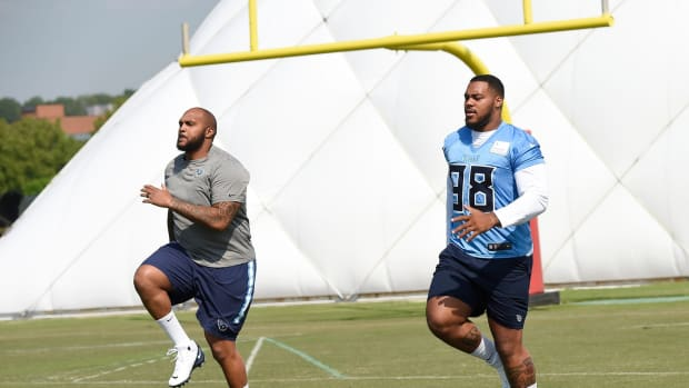 Tennessee Titans defensive end Jurrell Casey (99) and defensive tackle Jeffery Simmons (98) warm up during practice at Saint Thomas Sports Park Friday, July 26, 2019, in Nashville, Tenn.