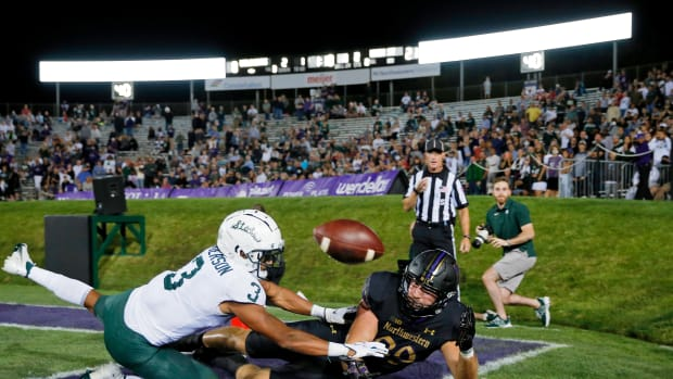 Northwestern Wildcats tight end Charlie Mangieri (89) is unable to stay inbounds as he reaches for the ball in front of Michigan State Spartans safety Xavier Henderson (3) during the second quarter at Ryan Field. Jon Durr-USA TODAY Sports