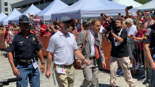 Nick Saban and the Alabama football team arrive at Mercedes-Benz Stadium in Atlanta for the Kickoff Classic against Miami on Sept. 4, 2021.