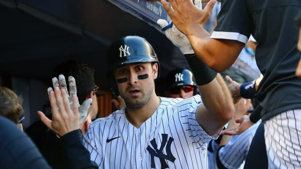 Yankees OF Joey Gallo high fives in dugout