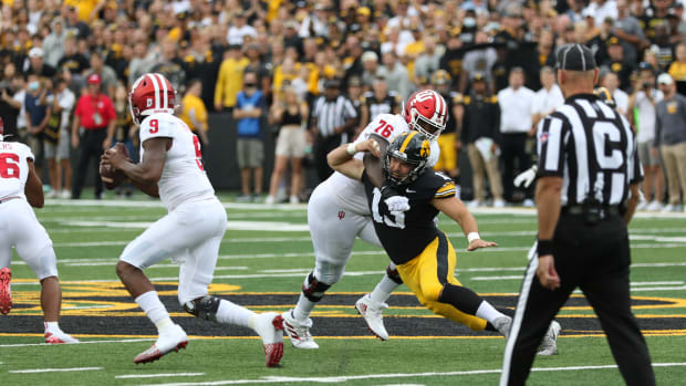 Iowa defensive end Joe Evans (13) works against Indiana tackle Matthew Bedford during a game on Sept. 4, 2021 at Kinnick Stadium.