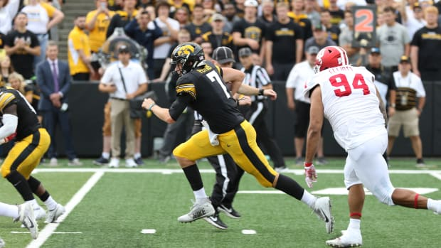 Iowa quarterback Spencer Petras (7) races ahead of Indiana's Demarcus Elliott during a game on Sept. 4, 2021 at Kinnick Stadium.