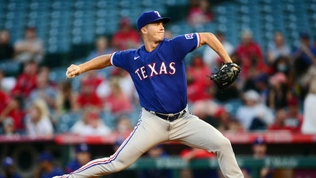 September 3, 2021; Anaheim, California, USA; Texas Rangers starting pitcher Glenn Otto (49) throws against the Los Angeles Angels during the first inning at Angel Stadium.