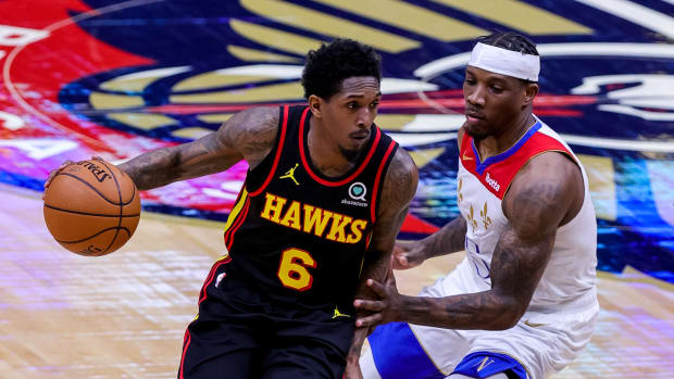 Atlanta Hawks guard Lou Williams dribbles around New Orleans Pelicans guard Eric Bledsoe