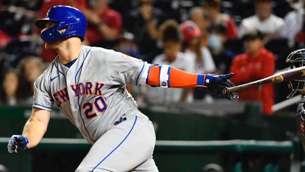 Sep 3, 2021; Washington, District of Columbia, USA; New York Mets first baseman Pete Alonso (20) hits an RBI single against the Washington Nationals during the tenth inning at Nationals Park. Mandatory