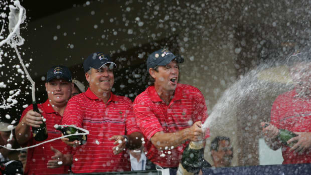 Captain Paul Azinger (right) celebrates the American Ryder Cup victory in 2008 with Kenny Perry (middle) and Chad Campbell.