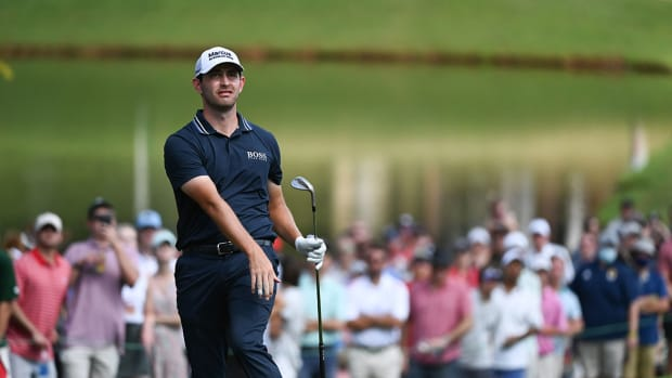 Patrick Cantlay plays the ninth hole at the 2021 Tour Championship.