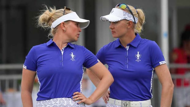 Madelene Sagstrom (left) and Nanna Koerstz Madsen have a tense chat on the 18th green during their Saturday four-ball match against Nelly Korda and Ally Ewing at the 2021 Solheim Cup.