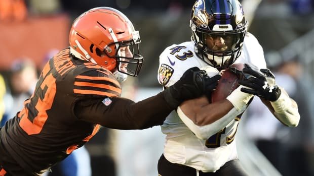 Dec 22, 2019; Cleveland, Ohio, USA; Cleveland Browns middle linebacker Joe Schobert (53) tackles Baltimore Ravens running back Justice Hill (43) during the second half at FirstEnergy Stadium. Mandatory Credit: Ken Blaze-USA TODAY Sports