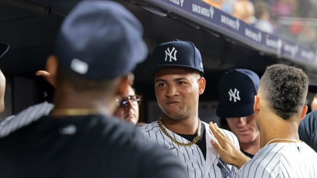 Yankees SP Luis Gil gets high fives in dugout