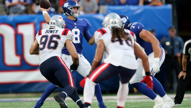 Daniel Jones, of the New York Giants, is shown as he gets ready to make a pass against the New England Patriots. Sunday, August 29, 2021.