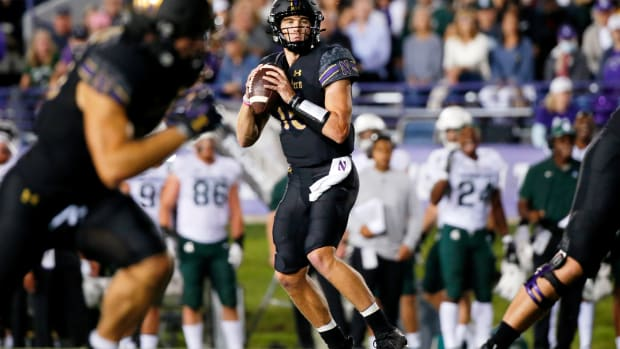 Northwestern Wildcats quarterback Hunter Johnson (15) looks to pass the ball against the Michigan State Spartans during the second quarter at Ryan Field. Jon Durr-USA TODAY Sports