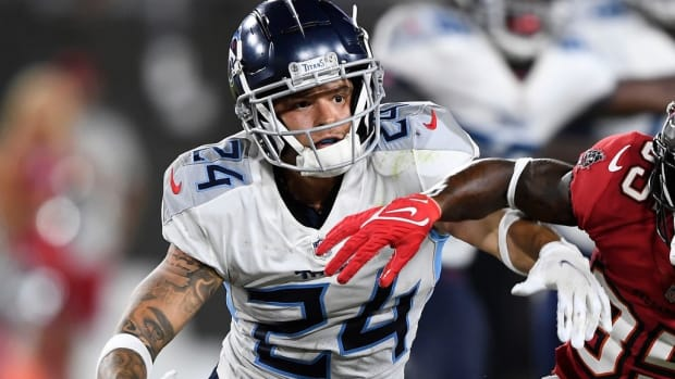 Tennessee Titans cornerback Elijah Molden (24) breaks up a pass intended for Tampa Bay Buccaneers wide receiver Jaydon Mickens (85) during the fourth quarter of an NFL preseason game at Raymond James Stadium Saturday, Aug. 21, 2021 in Tampa, Fla.
