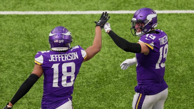 Dec 6, 2020; Minneapolis, Minnesota, USA; Minnesota Vikings wide receiver Justin Jefferson (18) celebrates his touchdown with wide receiver Adam Thielen (19) in the third quarter against the Jacksonville Jaguars at U.S. Bank Stadium. Mandatory Credit: Brad Rempel-USA TODAY Sports