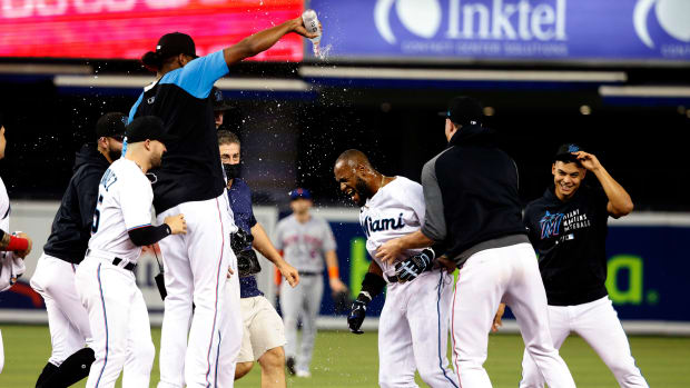 Sep 8, 2021; Miami, Florida, USA; The Miami Marlins celebrate with center fielder Bryan De La Cruz (77) after a walk off hit against the New York Mets during the 10th inning at loanDepot Park