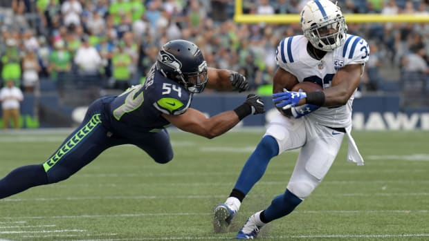 NFL: Indianapolis Colts at Seattle Seahawks Aug 9, 2018; Seattle, WA, USA; Indianapolis Colts running back Robert Turbin (33) is defended by Seattle Seahawks linebacker Bobby Wagner (54) in the first quarter during a preseason game at CenturyLink Field. Mandatory Credit: Kirby Lee-USA TODAY Sports
