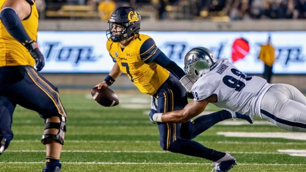 Chase Garbers tries to elude a Nevada tackler