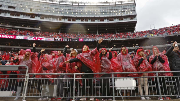 Ohio State Buckeyes fans cheer after the team recovered a fumble by Wisconsin Badgers quarterback Jack Coan during the fourth quarter of the NCAA football game at Ohio Stadium in Columbus, Ohio on Saturday, Oct. 26, 2019. Ohio State won 38-7.  Osu19wis Ac 50