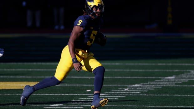 Nov 28, 2020; Ann Arbor, Michigan, USA; Michigan Wolverines quarterback Joe Milton (5) rushes against the Penn State Nittany Lions at Michigan Stadium. Mandatory Credit: Rick Osentoski-USA TODAY Sports