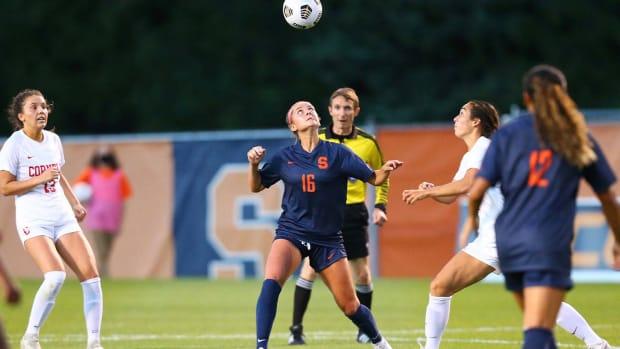 Koby Commandant heads the ball against Cornell
