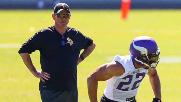 Jun 15, 2021; in Eagen, Minnesota, USA; Minnesota Vikings head coach Mike Zimmer looks on as free safety Harrison Smith (22) goes through drills at OTA at TCO Performance Center. Mandatory Credit: Harrison Barden-USA TODAY Sports