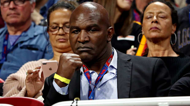 Why is Evander Holyfield back in the ring at 58 years old?