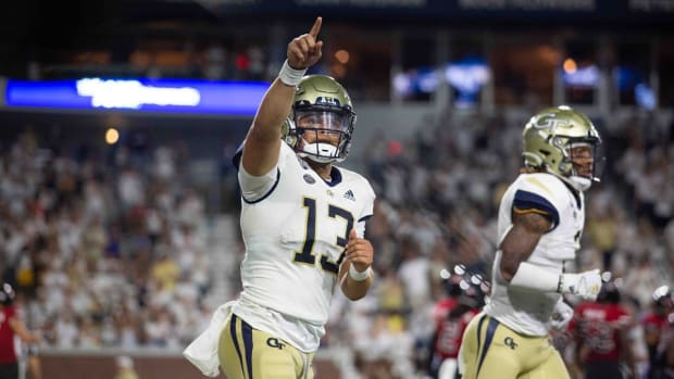 Sep 4, 2021; Atlanta, Georgia, USA; Georgia Tech Yellow Jackets quarterback Jordan Yates (13) points at the crowd after a touchdown against the Northern Illinois Huskies in the second half at Bobby Dodd Stadium. Mandatory Credit: Jenn Finch-USA TODAY Sports