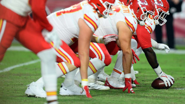 Aug 20, 2021; Glendale, Arizona, USA; The Kansas City Chiefs offensive line gets in position against the Arizona Cardinals during the second half at State Farm Stadium. Mandatory Credit: Joe Camporeale-USA TODAY Sports